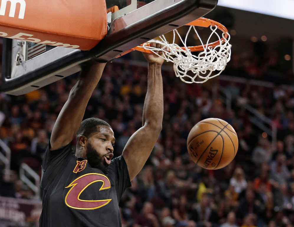 . Cleveland Cavaliers\' Tristan Thompson dunks the ball in the first half of an NBA basketball game against the Toronto Raptors, Wednesday, April 12, 2017, in Cleveland. (AP Photo/Tony Dejak)