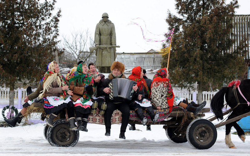 . People sit on a horse-drawn cart as they attend Christmas celebrations in the town of Richev, some 290 km south from Minsk, on January 7, 2013. Orthodox Christians celebrate Christmas on January 7 in the Middle East, Russia and other Orthodox churches that use the old Julian calendar instead of the 17th-century Gregorian calendar adopted by Catholics, Protestants, Greek Orthodox and commonly used  attendsin secular life around the world.   AFP PHOTO / VIKTOR DRACHEV/AFP/Getty Images