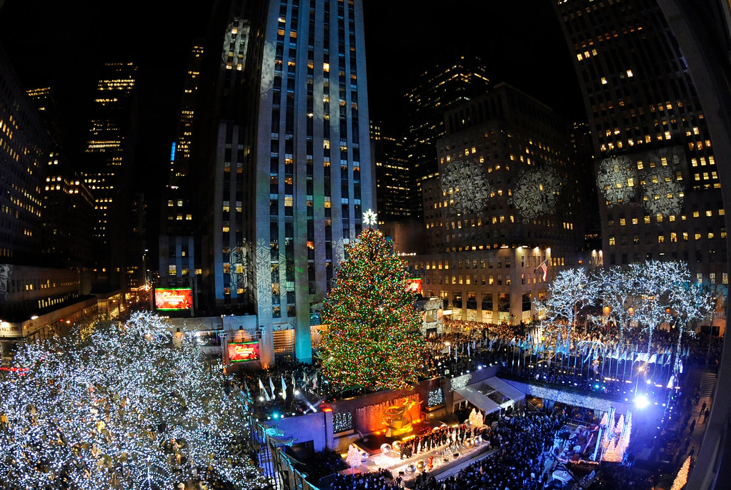. The 74-foot-tall Rockefeller Center Christmas Tree is lit using 30,000 energy efficient LED lights in the 79th annual lighting ceremony, Wednesday, Nov. 30, 2011 in New York.  (AP Photo/Henny Ray Abrams)