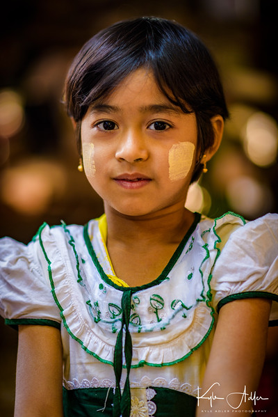 One of the family's daughters kindly poses for a portrait.  She wears thanaka, the tree bark paste that most Burmese women, and quite a few men, apply to their faces daily.