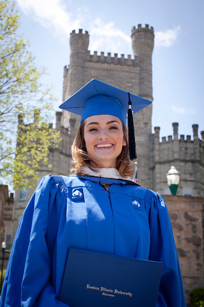Jill Grabiec poses for a photo in front of Old Main after receiving her Masters in Public Administration at the EIU Spring Commencement Ceremony on May 7, 2011.  (Jay Grabiec)