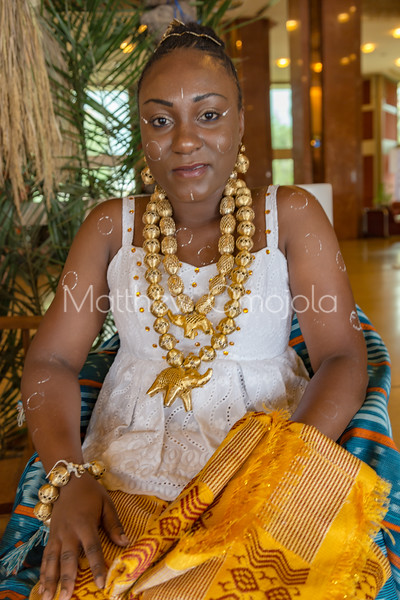 African ivorian culture on display at the president hotel Yamoussoukro. Young beautiful Ivorian lady wearing traditional african dress with gold jewelry. Promoting culture in Ivory Coast Cote d'Ivoire. Body decoration on the lady, African hairstyle.