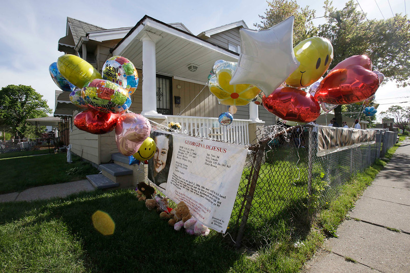 . Balloons fly outside the home of Gina DeJesus Tuesday, May 7, 2013, in Cleveland. DeJesus, Amanda Berry and Michelle Knight, who went missing separately about a decade ago, were found in a home just south of downtown Cleveland and likely had been tied up during years of captivity, said police, who arrested three brothers. (AP Photo/Tony Dejak)