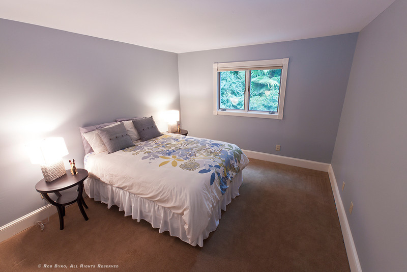 Second upstairs bedroom, again, overlooking backyard zen garden, pond and waterfall. Open the windows, close your eyes and fall to sleep to the sounds of a trickling brook!