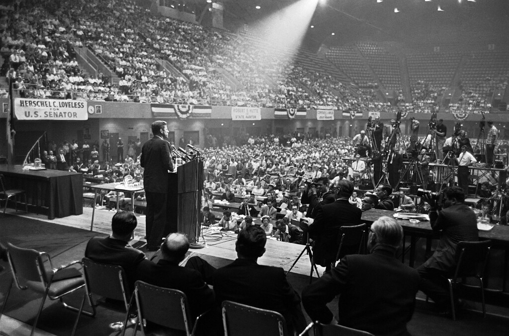. In this Aug. 21, 1960 file photo, illuminated by a spotlight, Sen. John F. Kennedy, Democratic presidential nominee, speaks to an audience in Des Moines, Iowa. (AP Photo)