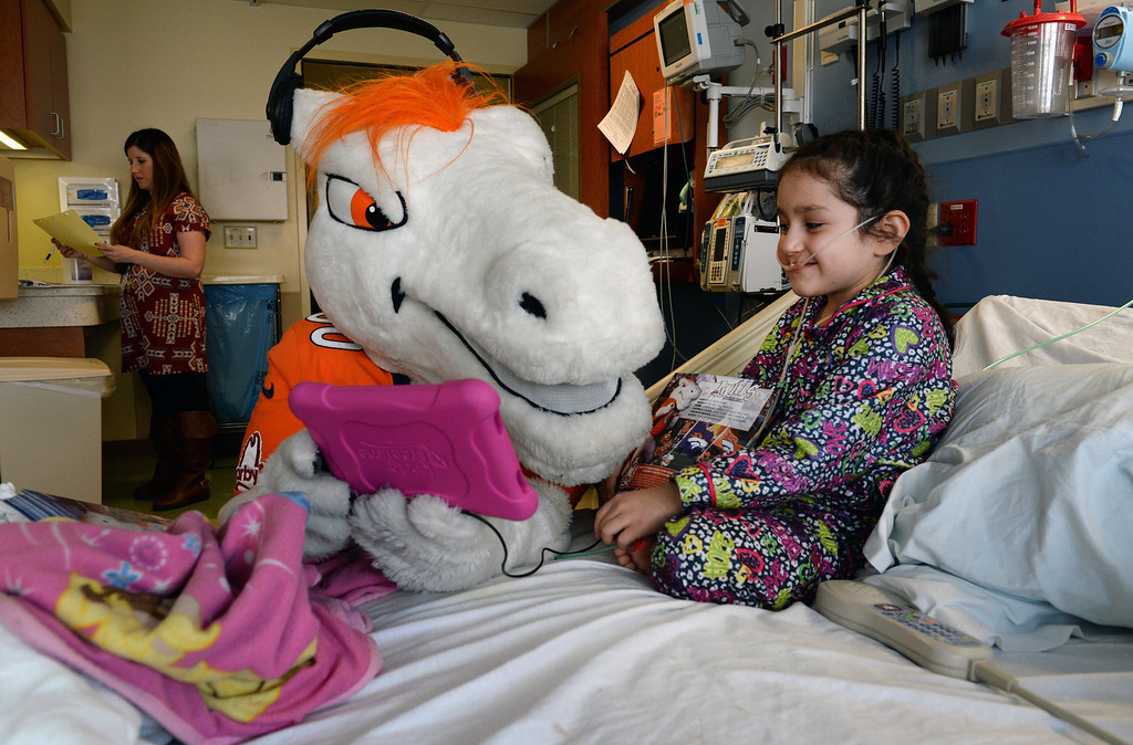 . Miles, the Broncos Mascot, visits with Karina Perez, 6, while in her bed in the Pediatric Intensive Care Unit at the  Rocky Mountain Hospital for Children in Denver, Co on January 14, 2014. (Photo By Helen H. Richardson/ The Denver Post)
