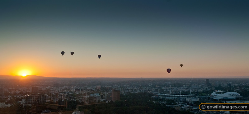 Hot air balloons at sunrise over Richmond and the Melbourne Cricket Ground