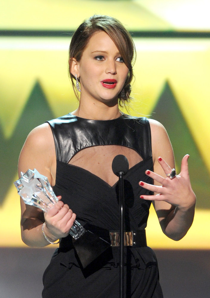 Description of . Actress Jennifer Lawrence onstage at the 18th Annual Critics' Choice Movie Awards held at Barker Hangar on January 10, 2013 in Santa Monica, California.  (Photo by Kevin Winter/Getty Images)