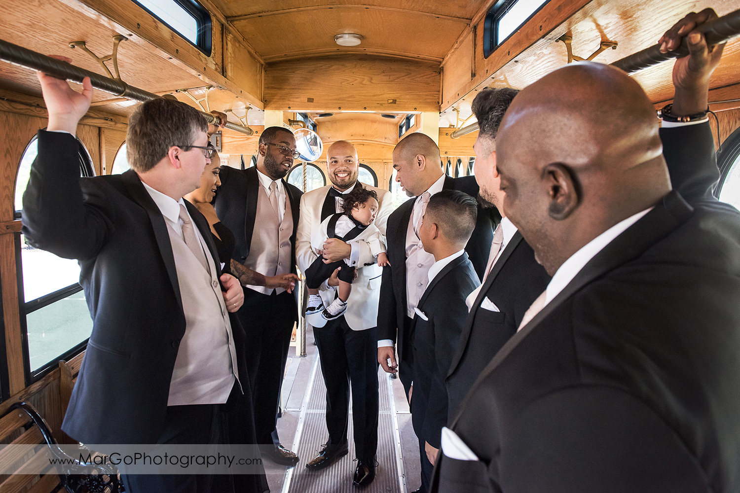 groom and groomsmen inside the tram at Sunol's Casa Bella