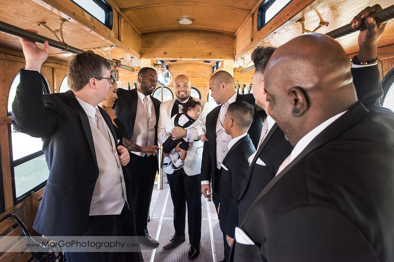 groom and groomsmen inside the tram at Sunol's Casa Bella