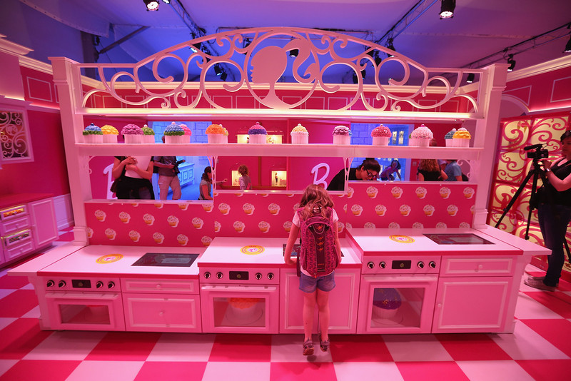 . A young visitor inspects the kitchen at the Barbie Dreamhouse Experience on May 16, 2013 in Berlin, Germany. The Barbie Dreamhouse is a life-sized house full of Barbie fashion, furniture and accessories and will be open to the public until August 25 before it moves on to other cities in Europe.  (Photo by Sean Gallup/Getty Images)