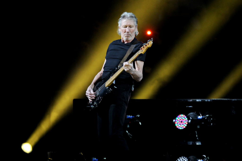 . This image released by Starpix shows Roger Waters performing at the 12-12-12 The Concert for Sandy Relief at Madison Square Garden in New York on Wednesday, Dec. 12, 2012. Proceeds from the show will be distributed through the Robin Hood Foundation. (AP Photo/Starpix, Dave Allocca)