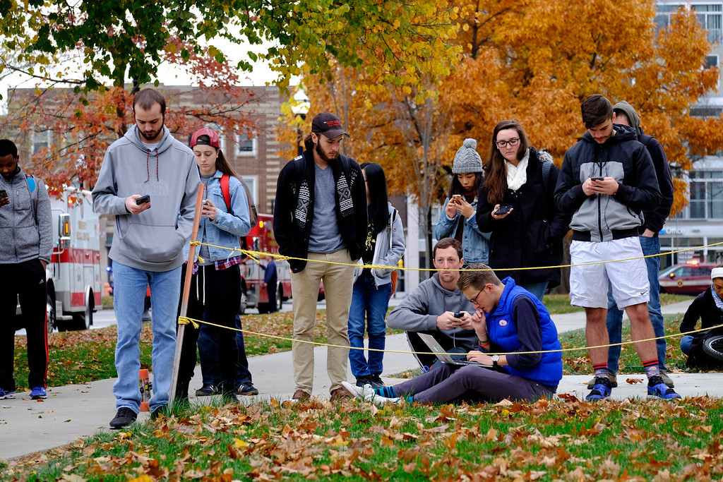 . Students gather near the scene of an attack on the campus at Ohio State University on Monday, Nov. 28, 2016, in Columbus, Ohio. (Adam Cairns/The Columbus Dispatch via AP)