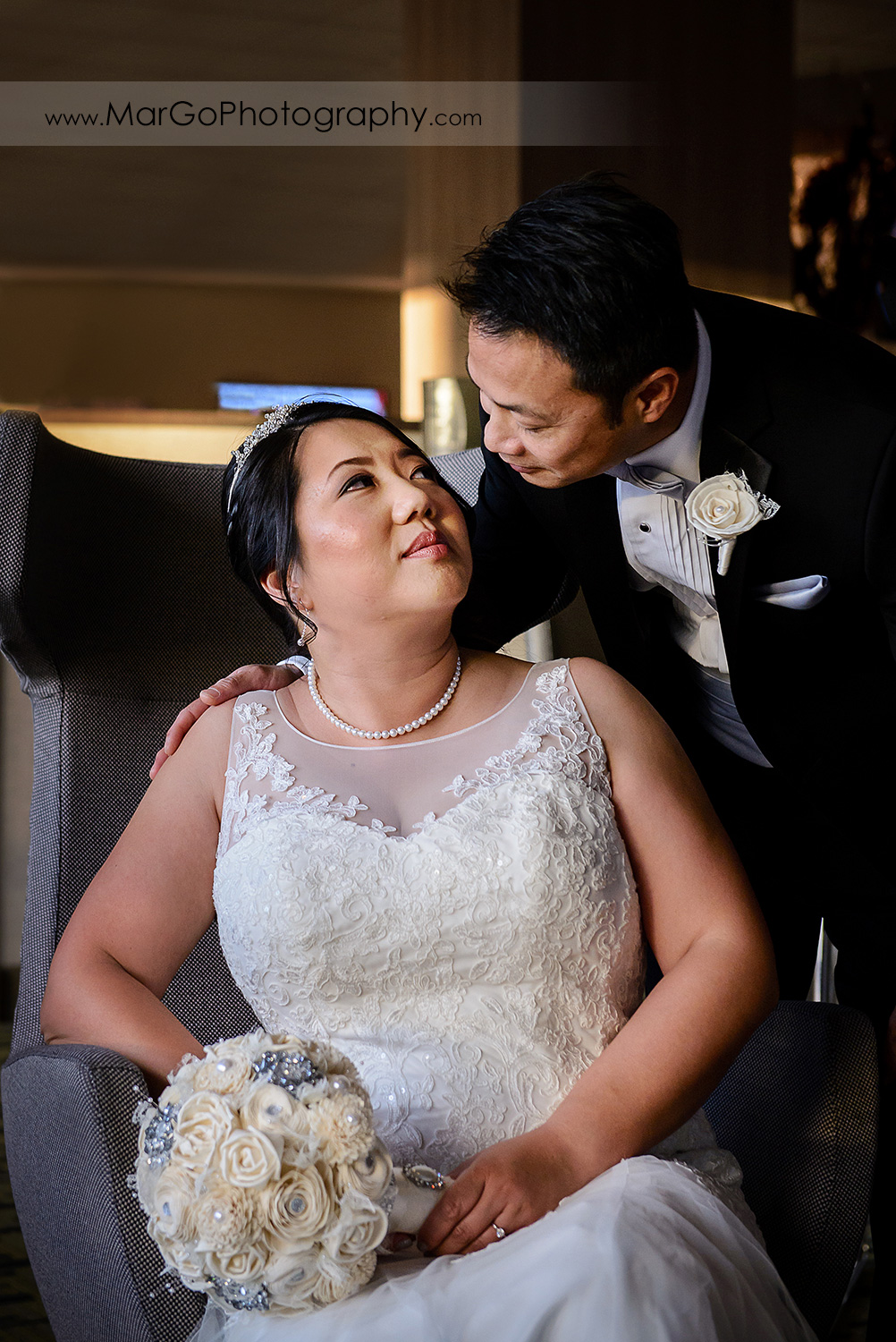 portrait of bride and groom in the lobby of Hilton San Francisco Airport Bayfront in Burlingame