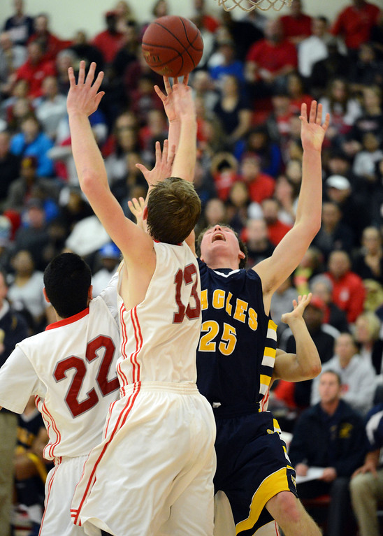 . Arroyo Grande\'s Andrew Midyett (25) tires to shoot over Redondo Union\'s Chris Henderson (22) and Sebastian Lindner (13) in a CIF Southern Section Division II-A semifinal boys basketball game Tuesday night in Redondo Beach.  Redondo won the game 55-41 and advances to the title game. 20130226 Photo by Steve McCrank / Daily Breeze