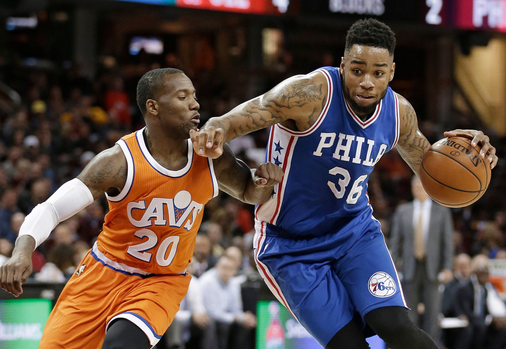 . Philadelphia 76ers\' Shawn Long (36) drives to the basket against Cleveland Cavaliers\' Kay Felder (20) in the second half of an NBA basketball game, Friday, March 31, 2017, in Cleveland. (AP Photo/Tony Dejak)