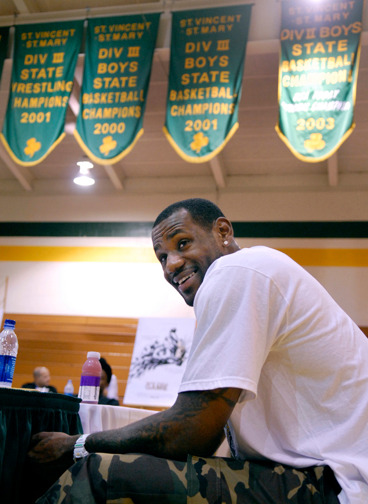 """. Jeff Forman/JForman@News-Herald.com LeBron James answers questions about the film \""""More Than a Game\"""" Friday in the St. Vincent-St. Mary gym."""