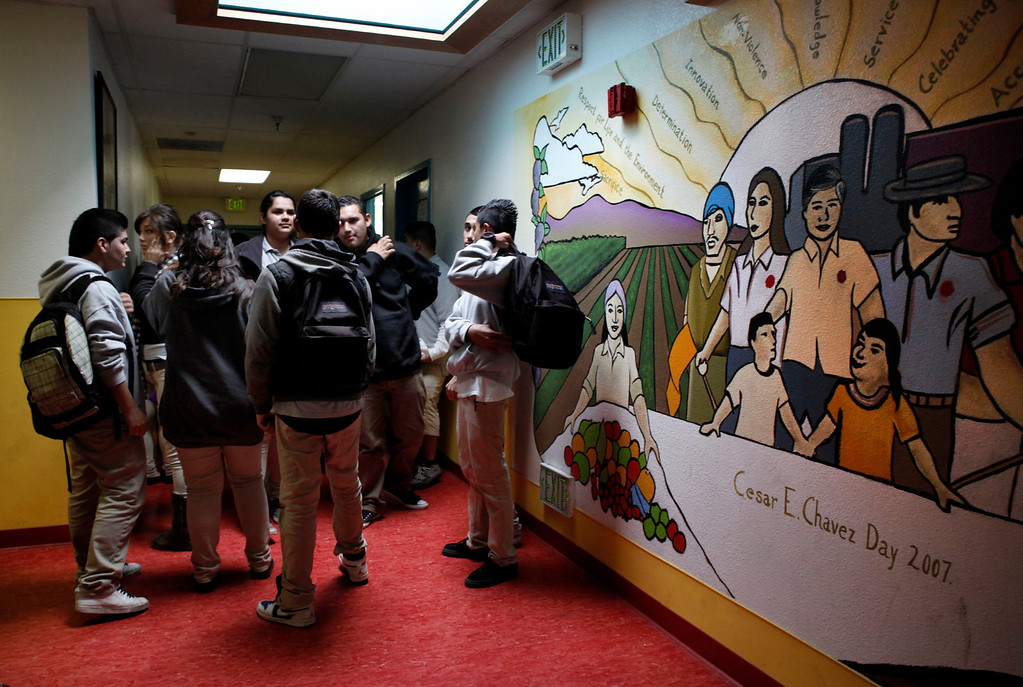 . Next to a mural of Cesar Chavez, students mill in the hallway between fifth and sixth period at ACE Charter High School in San Jose, Calif. on Wednesday, Dec. 05, 2012. The school is located in an unused wing of the Mexican American Community Services Agency. (Karl Mondon/Staff)