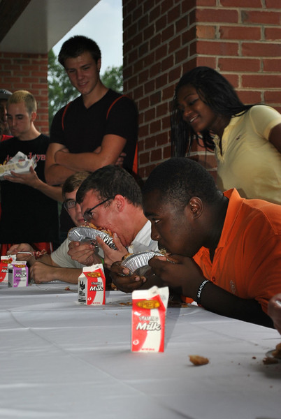 Students competing in a pie eating contest.