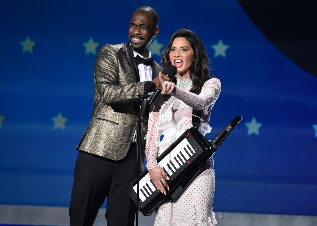 . Jay Pharoah, left, and Host Olivia Munn speak at the 23rd annual Critics\' Choice Awards at the Barker Hangar on Thursday, Jan. 11, 2018, in Santa Monica, Calif. (Photo by Chris Pizzello/Invision/AP)