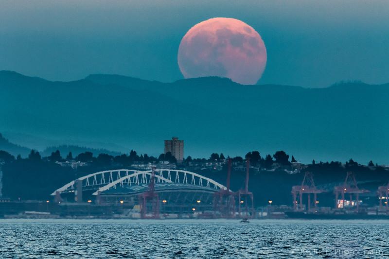 Full moon over CenturyLink Field in Seattle