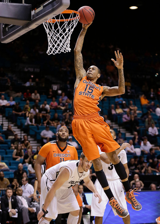 . Oregon State\'s Eric Moreland (15) dunks the ball against Colorado during the first half of a Pac-12 Conference tournament NCAA college basketball game, Wednesday, March 13, 2013, in Las Vegas. (AP Photo/Julie Jacobson)