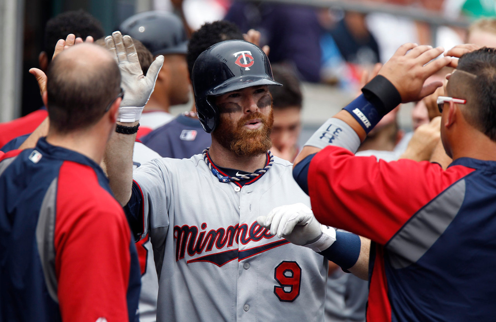 . Minnesota\'s Ryan Doumit soaks it up in the dugout after his three-run home run off Tigers starter Justin Verlander in the fifth inning. (AP Photo/Duane Burleson)