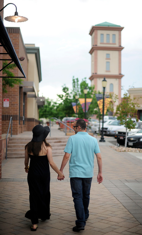 . Summer Love series with Yanira  and Bryce Owens  stroll along E. Cedar Ave at Aurora City Place after dinner on Friday, June 21, 2013. (Photo By Cyrus McCrimmon/The Denver Post)