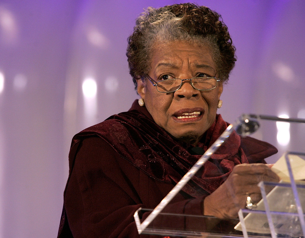 """. Poet Maya Angelou reads her poem \""""Amazing Peace\"""" during the 2005 Christmas Pageant of Peace and National Christmas Tree lighting ceremony December 1, 2005 on the Ellipse in Washington, DC.  (Photo by Chip Somodevilla/Getty Images)"""