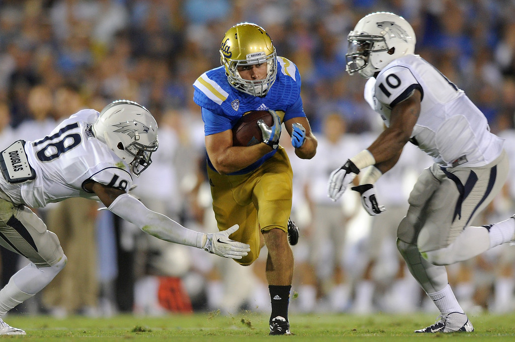 . UCLA RB Steven Manfro breaks a big run in the second quarter against Nevada, Saturday, August 31, 2013, at the Rose Bowl. (Michael Owen Baker/L.A. Daily News)