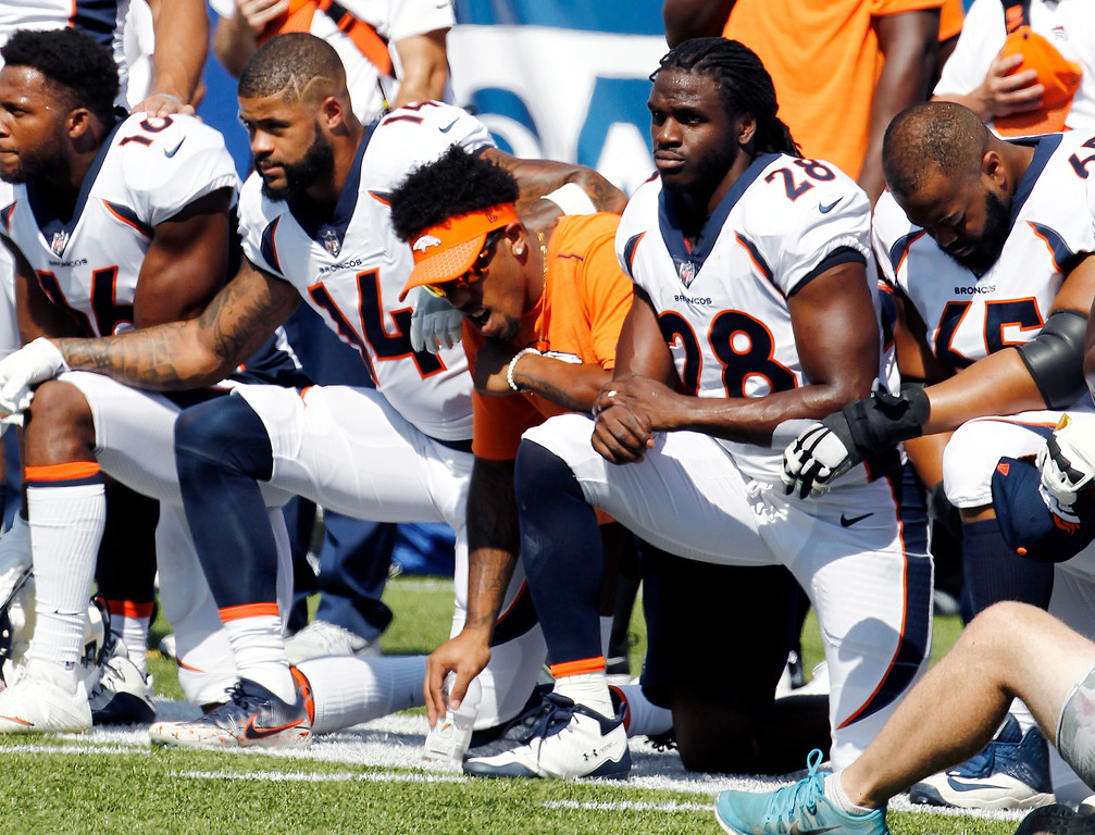 . Denver Broncos players, including Jamaal Charles (28) kneel during the national anthem prior to an NFL football game against the Buffalo Bills, Sunday, Sept. 24, 2017, in Orchard Park, N.Y. (AP Photo/Jeffrey T. Barnes)