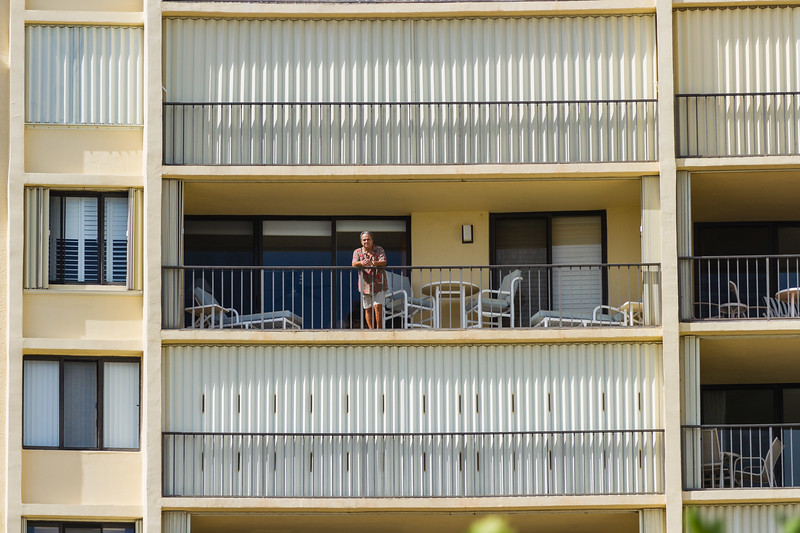 Gary Freedman stands on his 12th story balcony at the Ocean Trail Condominium on Wednesday, October 12, 2016. Gary and his wife Ruth chose to stay in their condo during Hurricane Matthew after an evacuation order was issued. (Joseph Forzano / The Palm Beach Post)