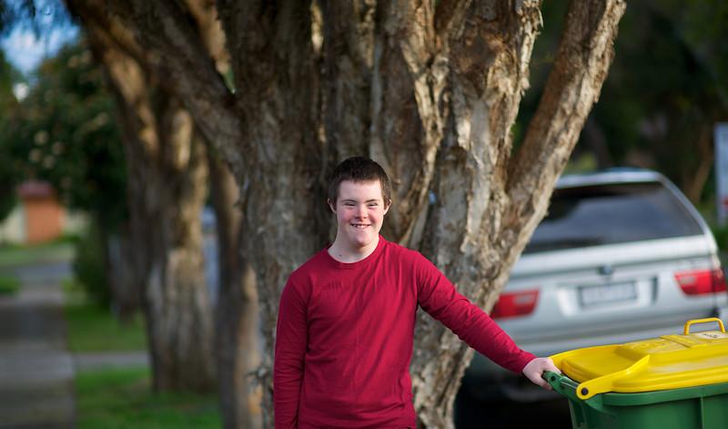 Teenage boy standing outside