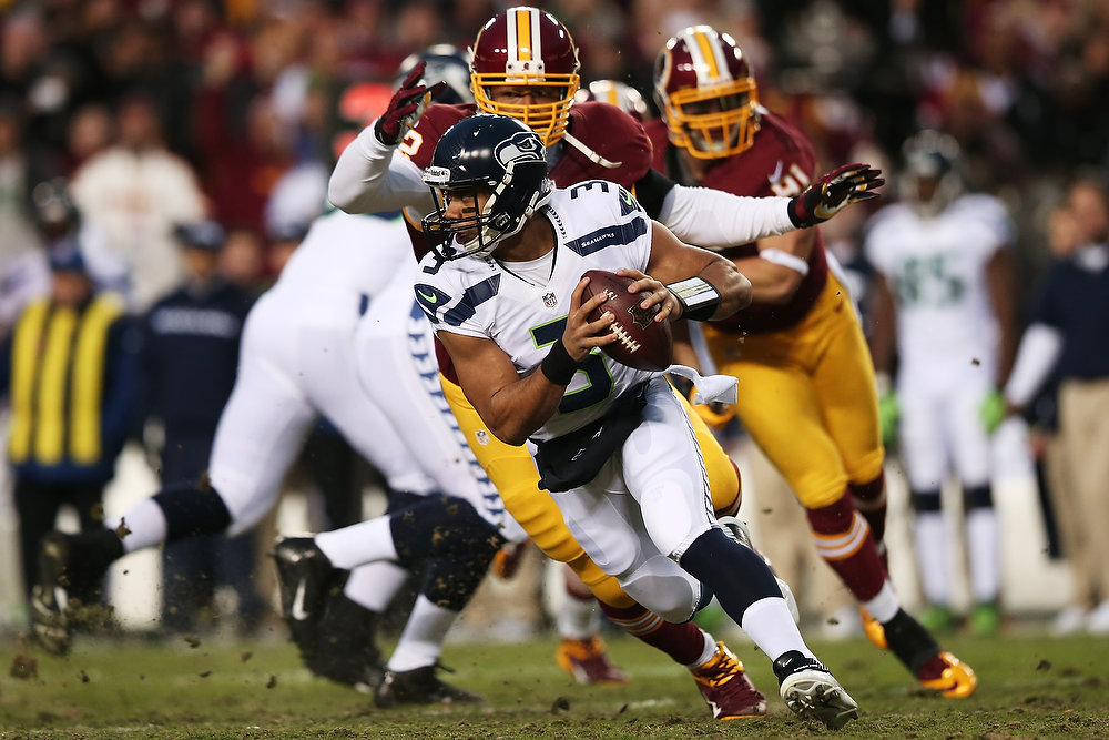 Description of . Russell Wilson #3 of the Seattle Seahawks is sacked by Stephen Bowen #72 of the Washington Redskins on a third down in the first quarter of the NFC Wild Card Playoff Game at FedExField on January 6, 2013 in Landover, Maryland.  (Photo by Win McNamee/Getty Images)