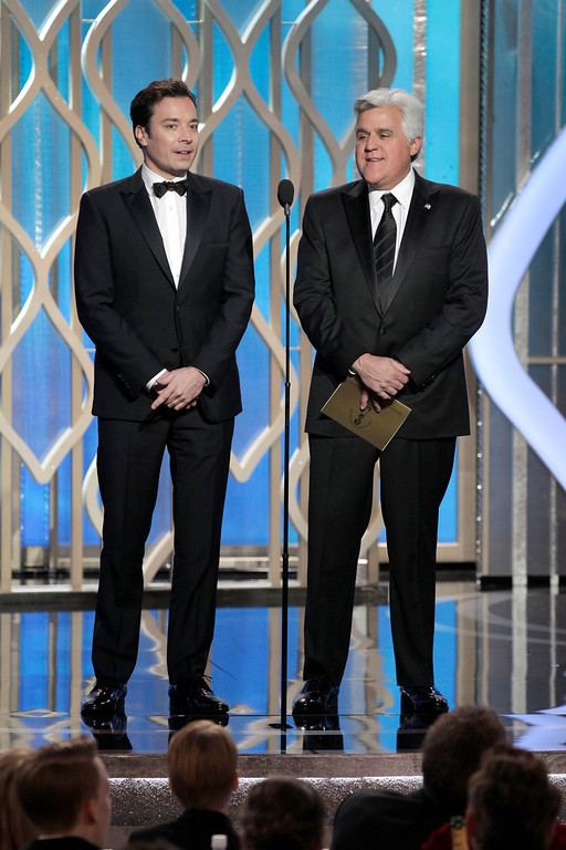 . BEVERLY HILLS, CA - JANUARY 13: In this handout photo provided by NBCUniversal,  Jimmy Fallon and Jay Leno on stage to present during the 70th Annual Golden Globe Awards at the Beverly Hilton Hotel International Ballroom on January 13, 2013 in Beverly Hills, California. (Photo by Paul Drinkwater/NBCUniversal via Getty Images)