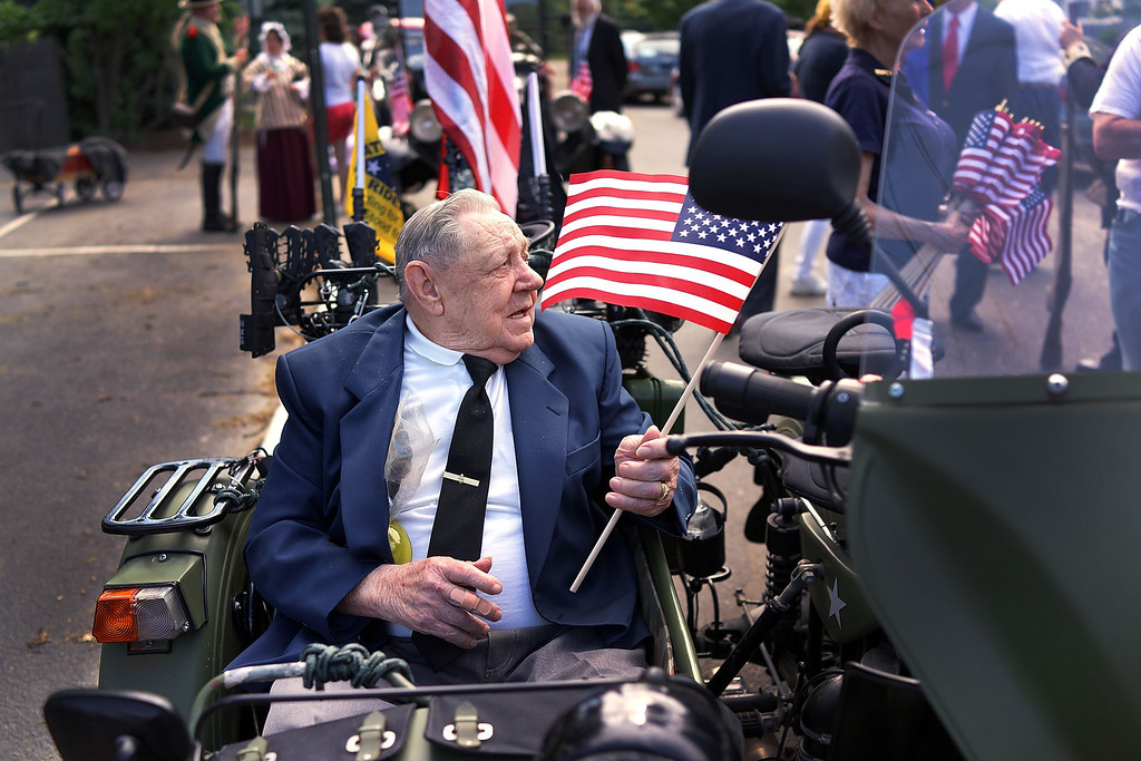 . Joseph Felner (88) a participant in the landing at D-Day during WW2, participates in the annual Memorial Day Parade on May 26, 2014 in Fairfield, Connecticut. Across America towns and cities will be celebrating veterans of the United States Armed Forces and the sacrifices they have made. Memorial Day is a federal holiday in America and has been celebrated since the end of the Civil War.  (Photo by Spencer Platt/Getty Images)