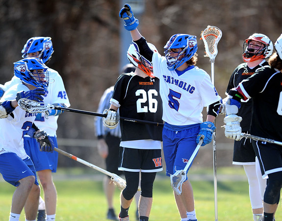4/10/2019 Mike Orazzi | Staff St. Paul's Brycen Kennedy (5) celebrates a goal during boys lacrosse with Watertown in Bristol Wednesday.