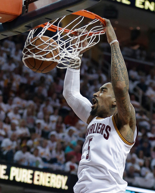 . Cleveland Cavaliers\' J.R. Smith (5) dunks the ball against the Detroit Pistons in the first half in Game 1 of a first-round NBA basketball playoff series, Sunday, April 17, 2016, in Cleveland. (AP Photo/Tony Dejak)