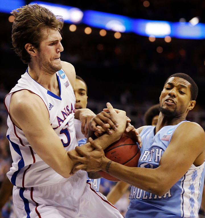 . Kansas center Jeff Withey (5) battles for a rebound with North Carolina guard Leslie McDonald (2) during the first half of a third-round game in the NCAA college basketball tournament at the Sprint Center in Kansas City, Mo., Sunday, March 24, 2013. (AP Photo/Orlin Wagner)