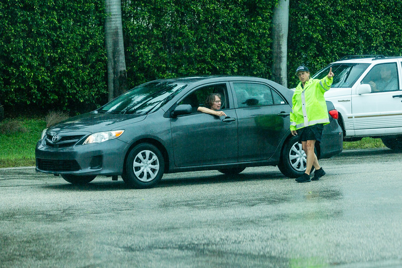 An Ocean Ridge police officer directs a driver coming over the Atlantic Avenue bridge in Boynton Beach, on Tuesday, September 3, 2019. [JOSEPH FORZANO/palmbeachpost.com]