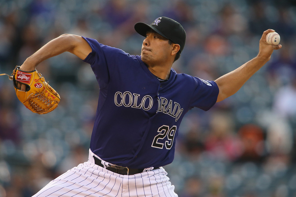 . Starting pitcher Jorge De La Rosa #29 of the Colorado Rockies delivers against the San Francisco Giants at Coors Field on April 21, 2014 in Denver, Colorado.  (Photo by Doug Pensinger/Getty Images)