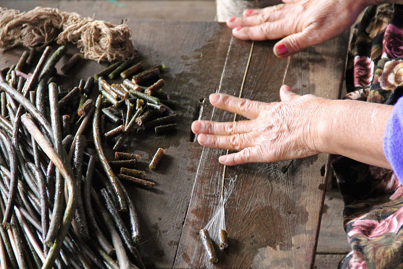 making thread out of lotus flower stalks