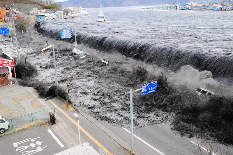 . In this photo taken on Friday, March 11, 2011, a tsunami floods over the breakwater protecting the coastal city of Miyako at Heigawa estuary area after northeastern Japan was hit by a powerful earthquake. (AP Photo/Mainichi Shimbun, Tomohiko Kano)