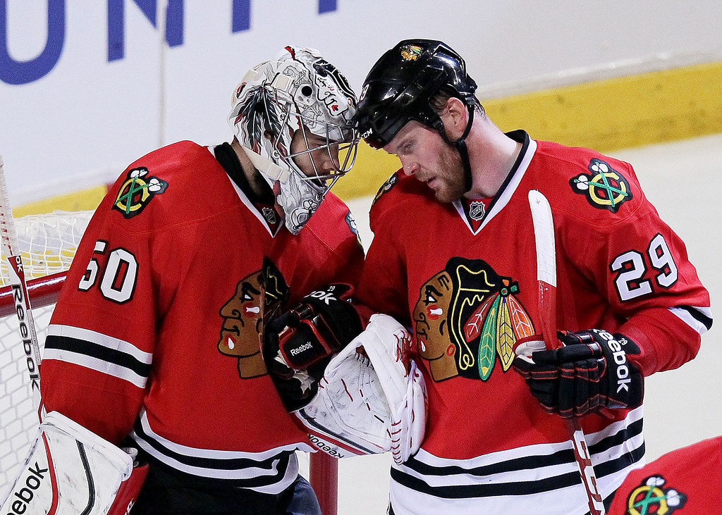 . Corey Crawford #50 and Bryan Bickell #29 of the Chicago Blackhawks celebrate their 3 to 1 win over the Los Angeles Kings in Game One of the Western Conference Final during the 2014 Stanley Cup Playoffs at United Center on May 18, 2014 in Chicago, Illinois.  (Photo by Tasos Katopodis/Getty Images)