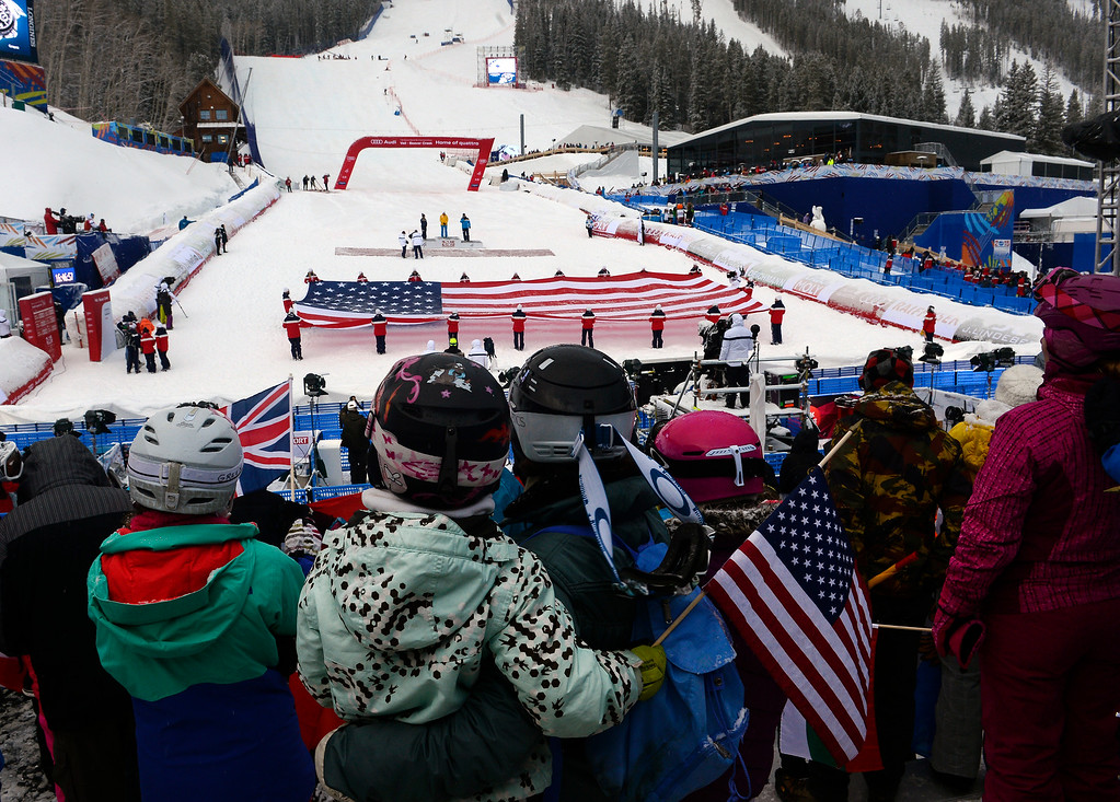 . BEAVER CREEK, CO - FEBRUARY 15: Sarah Green, right and her daughters Emily, with arm around her, and Sophie, left in green, both 8, enjoy the closing ceremonies for the FIS Alpine World Ski Championships in Beaver Creek, CO.  The ceremonies took place at the base of the races at Redtail Stadium February 15, 2015. (Photo By Helen H. Richardson/The Denver Post)
