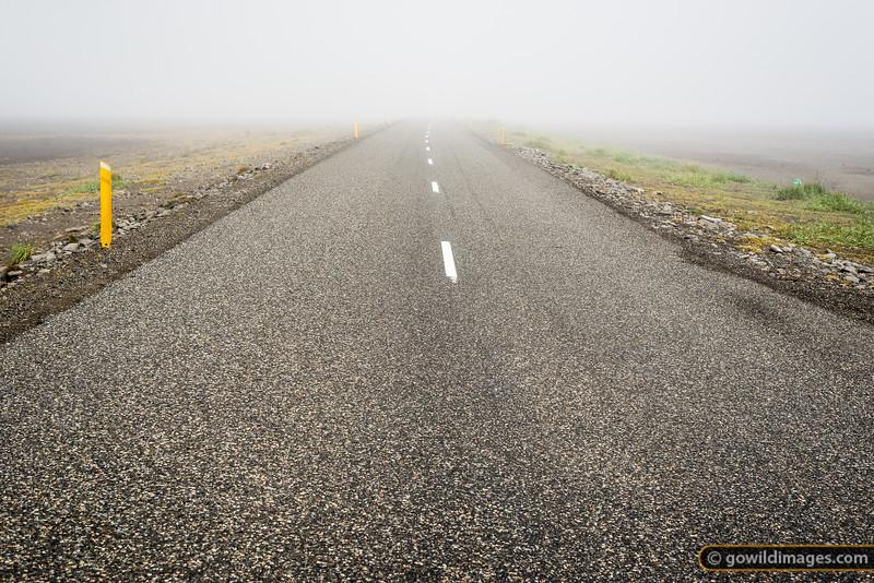Road 1 fades into the fog