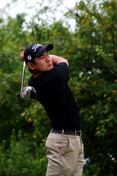 Andrew Yun of Chandler, Ariz., tees off in the second round Wednesday.