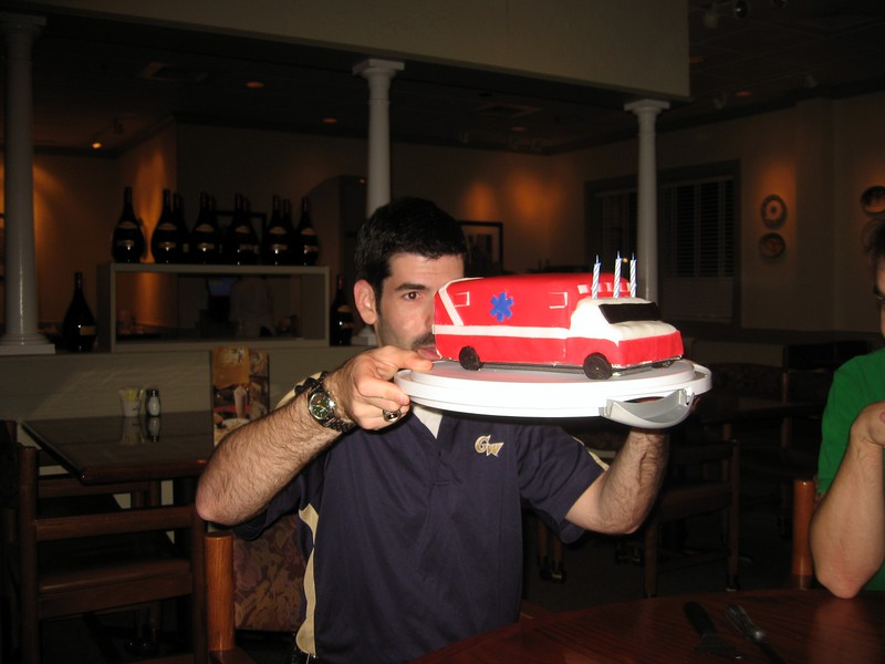 David inspects the cake