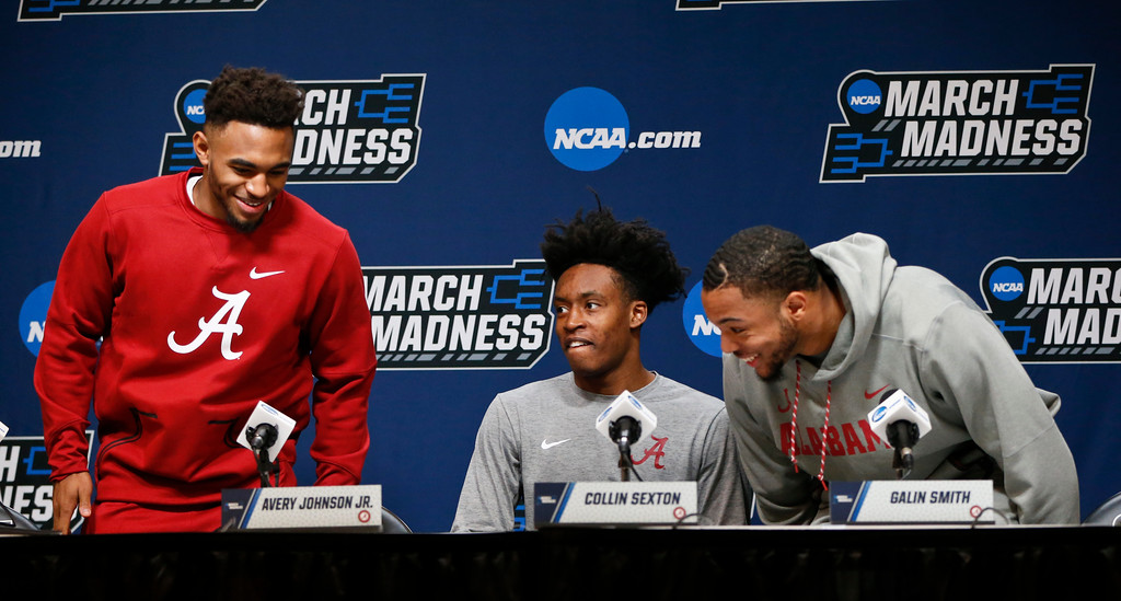 . Alabama\'s Avery Johnson Jr., left, Collin Sexton, center, and Galin Smith take a seat to answer questions during a news conference at the NCAA men\'s college basketball tournament, Friday, March 16, 2018, in Pittsburgh. Alabama faces Villanova in a second-round game on Saturday. (AP Photo/Keith Srakocic)