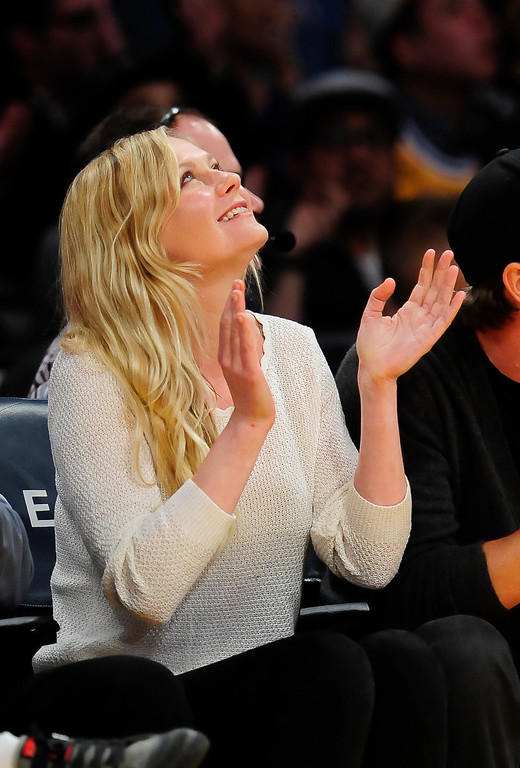 . Actress Kristen Dunst attends an NBA basketball game between theNew Orleans Pelicans and Los Angeles Lakers, Tuesday, March 4, 2014, in Los Angeles. The Pelicans won 132 to 125. (AP Photo/Gus Ruelas)